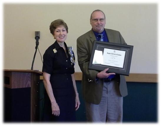 Sylvia Waldron presenting the award to Chris Mathews